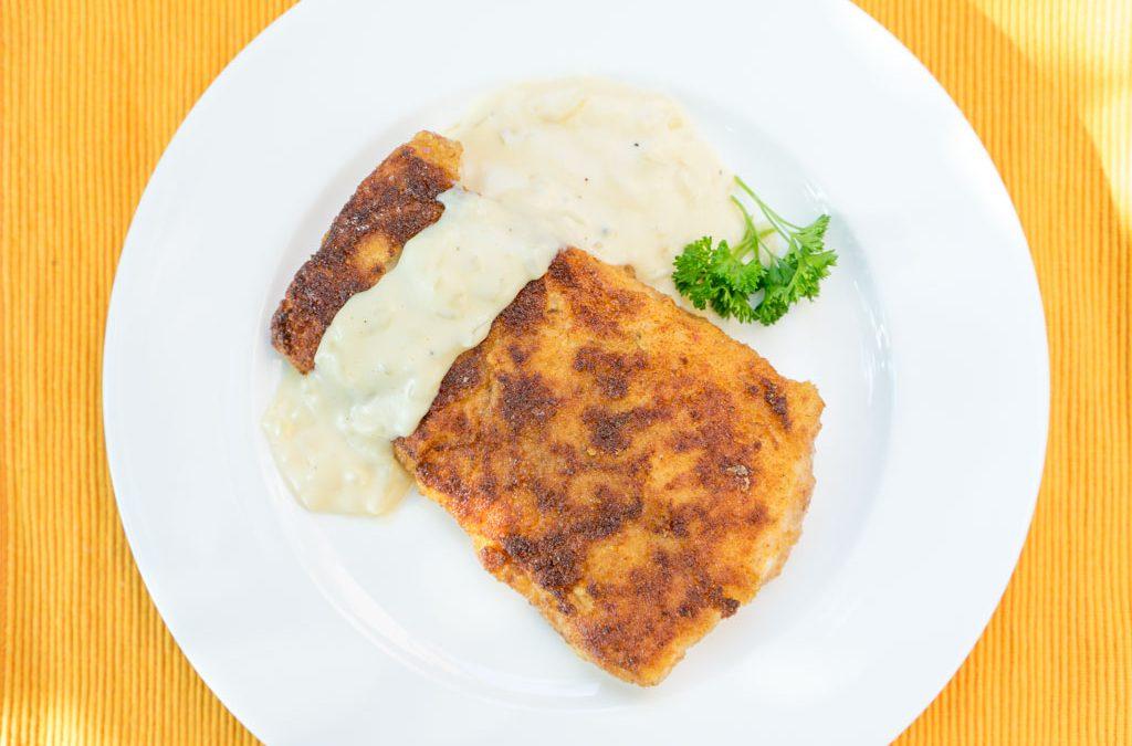 Gebakken vis met uiensaus, met dit recept zet je het in een handomdraai op tafel